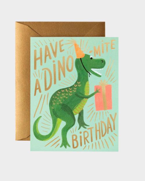 syntymäpäiväkortti jossa dinosaurus lahjapaketin kanssa